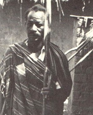 Joseph Kapuufi Wangao, Traditional King of Nkansi at his Palace in Sumbawanda in 1964.