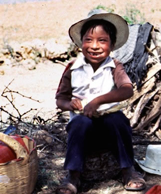 Seven-year-old Zapotec boy eating a tortilla in the fields of Oaxaca, Mexico, near the village of La Paz. (D. P. Fry photo collection)