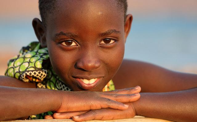 A schoolgirl relaxing on a beach in Karema, Tanzania