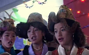 """Rural students dancing at a village school function in the Puga Valley of the Chang Tang region, southeastern Ladakh. (Screenshot from the video """"Ladakh 'Six Souls of Puga: The Wind of Change'"""" by Chamba Kaysar on YouTube, Creative Commons license)"""