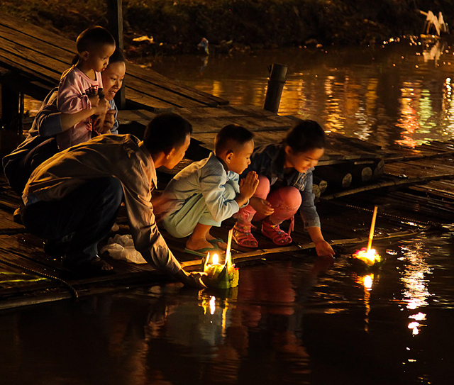 People floating krathong rafts during the Loi Krathong festival in Chiang Mai