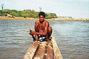 A Yanadi fisherman paddling a log boat (Photo by Only the Best that was on NationMaster.com and copyrighted, but released for all uses without reservation)