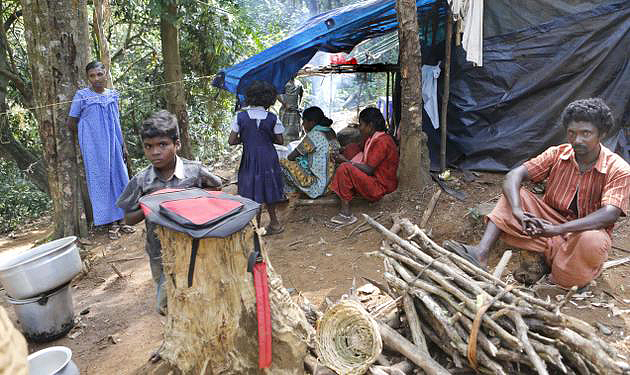 A tribal family at Attathode, probably Malapandaram