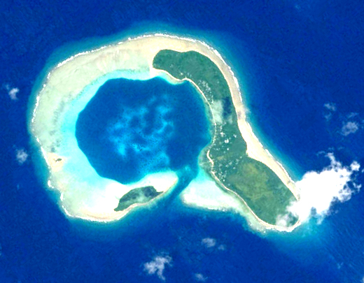 Image of Ifaluk Atoll from space that shows the channel into the lagoon