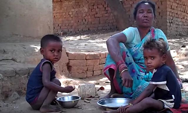Birhor woman with children