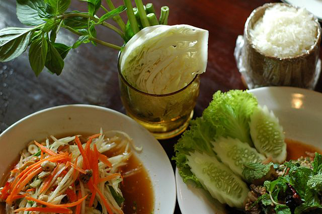 Sticky rice and other dishes are commonly eaten in Isan
