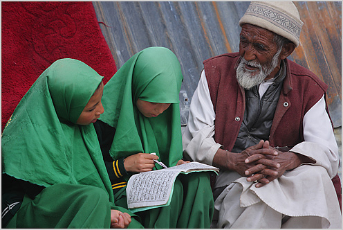 Muslim girls in Ladakh reciting lessons from the Quran with a mullah
