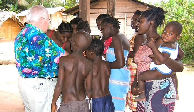 John Chittick speaking with some women and children in Africa