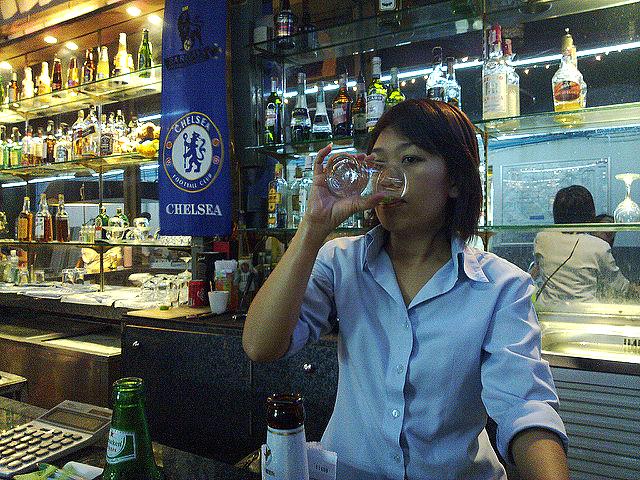 A waitress at a street bar in Bangkok