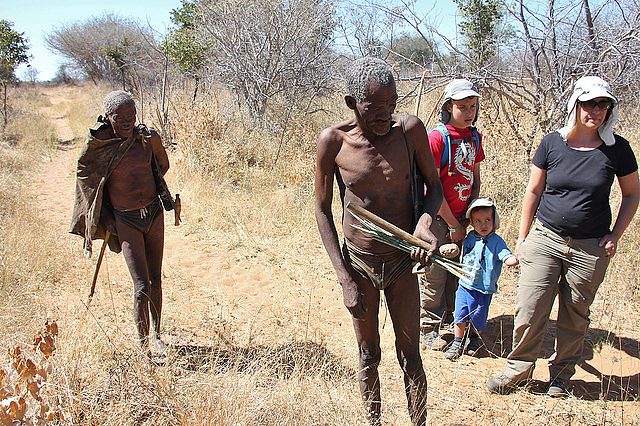 Two Ju/'hoansi hunters show tourists how they track during a hunt