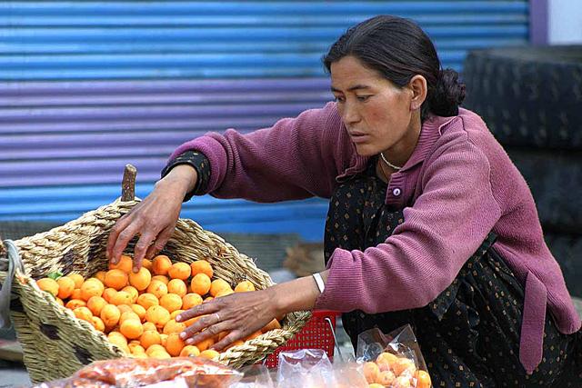 A Ladakhi woman vendor selling food in a market