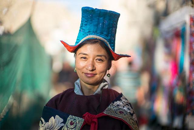 A Ladakhi woman wearing a traditional hat