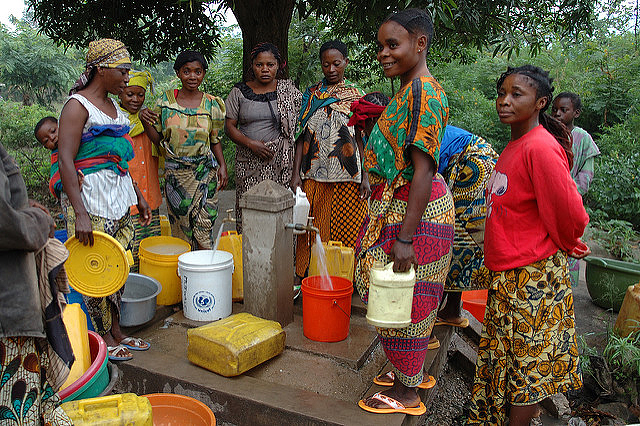 Women getting unpolluted water at a village fountain near Lake Tanganyika