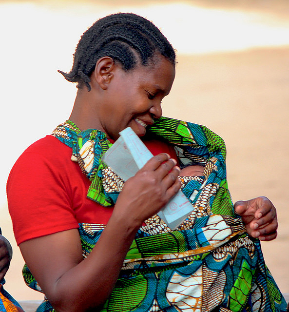 A woman waiting with her baby at the Mtowisa Health Center