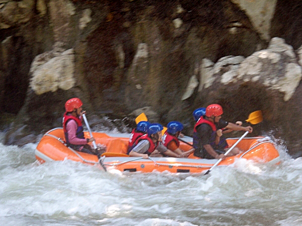 A group of people white water rafting on the Kampar River, Gopeng