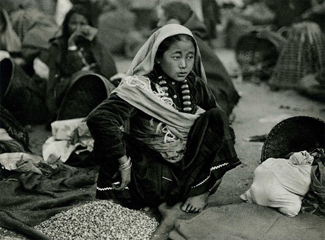 A Lepcha girl selling nuts at a street market in Darjeeling in 1928