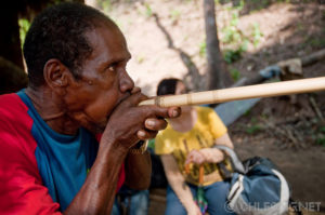 A Batek man shows tourists how he uses his blowpipe in a village along the Tembeling River