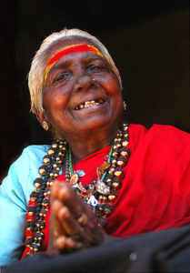 Lady at Sabarimala, probably Malapandaram, selling traditional healing oils made from forest herbs (Photo by Ragesh Vasudevan on Flickr, Creative Commons license)