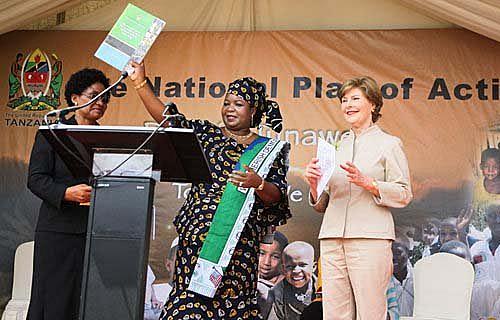 First ladies Salma Kikete of Tanzania, center, and Laura Bush, U.S., right