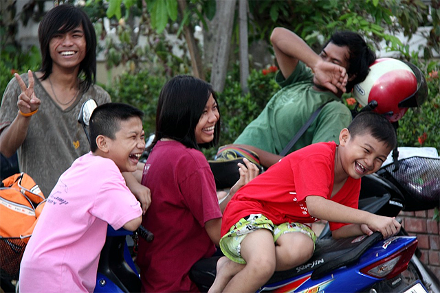 A group of Thai people laughing