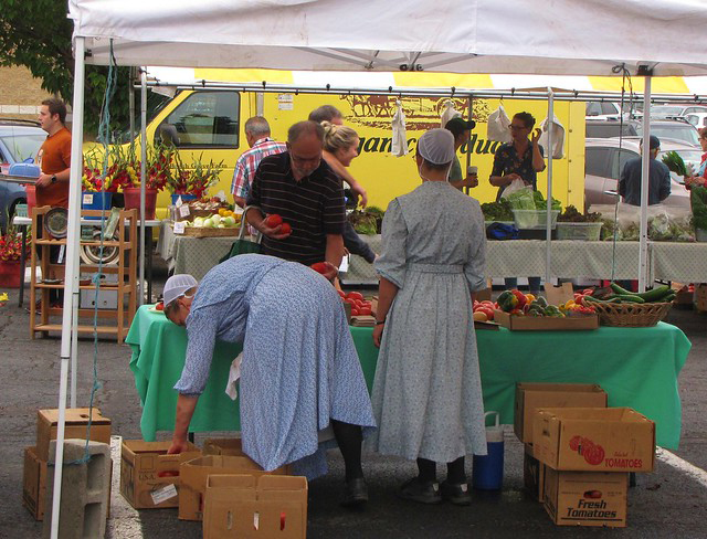 Two Amish women selling farm produce at the Williamsport Grower's Market, August 2018