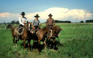 Hutterites on horseback in Alberta, 1982