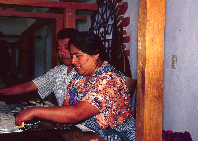 A Zapotec woman and her husband weaving in their workshop in Teotitlán del Valle, Oaxaca