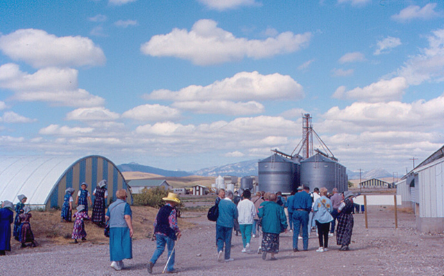 A group taking a tour of the Milford Colony, Montana, work buildings