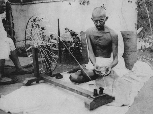 Gandhi spinning yarn on a charkha in the late 1940s