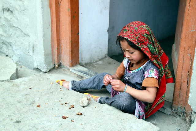 A girl in Turtuk plays with some apricot seeds (Photo by Fulvio Spada on Flickr, Creative Commons license)