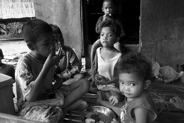 Mangyan children eating biscuits