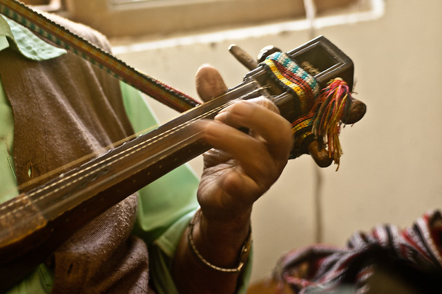 Sonam Lepcha playing a self-designed, four-string musical instrument