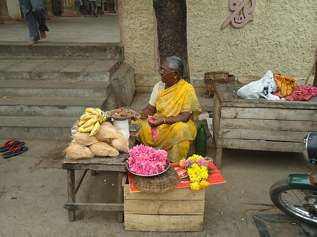 A seller of produce at a market in the Palni Hills